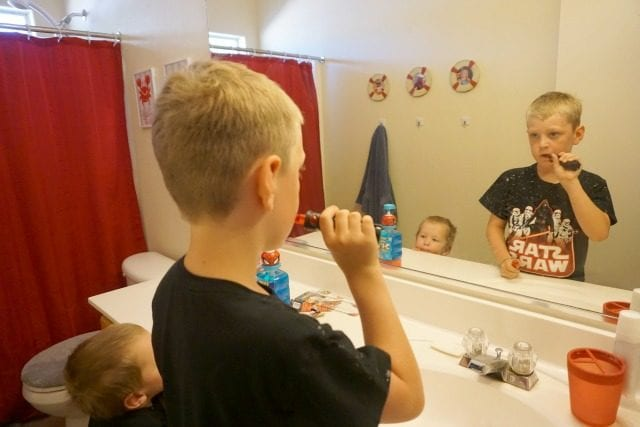 Boys brushing teeth